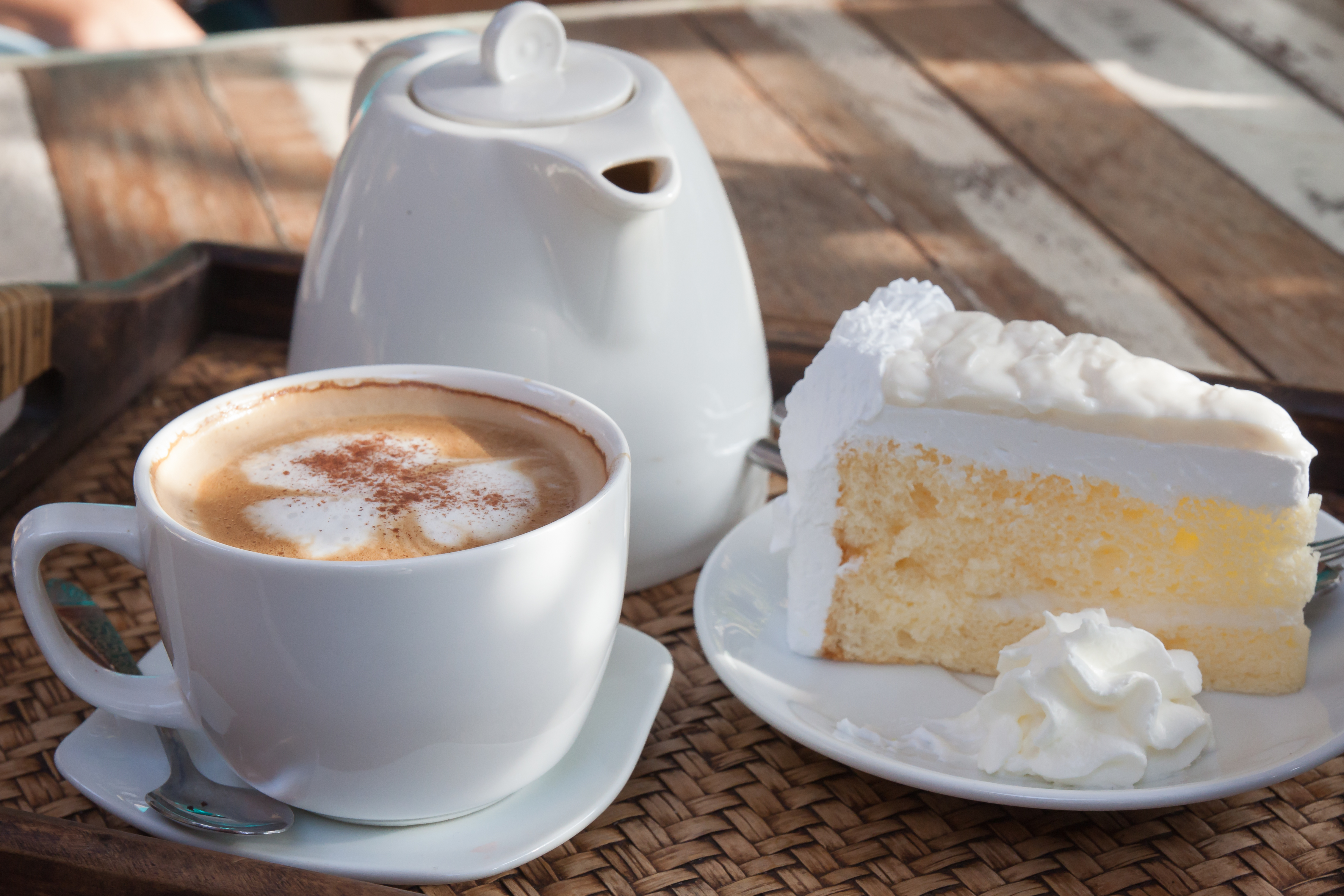 Coffee and cake are placed on a wooden table.