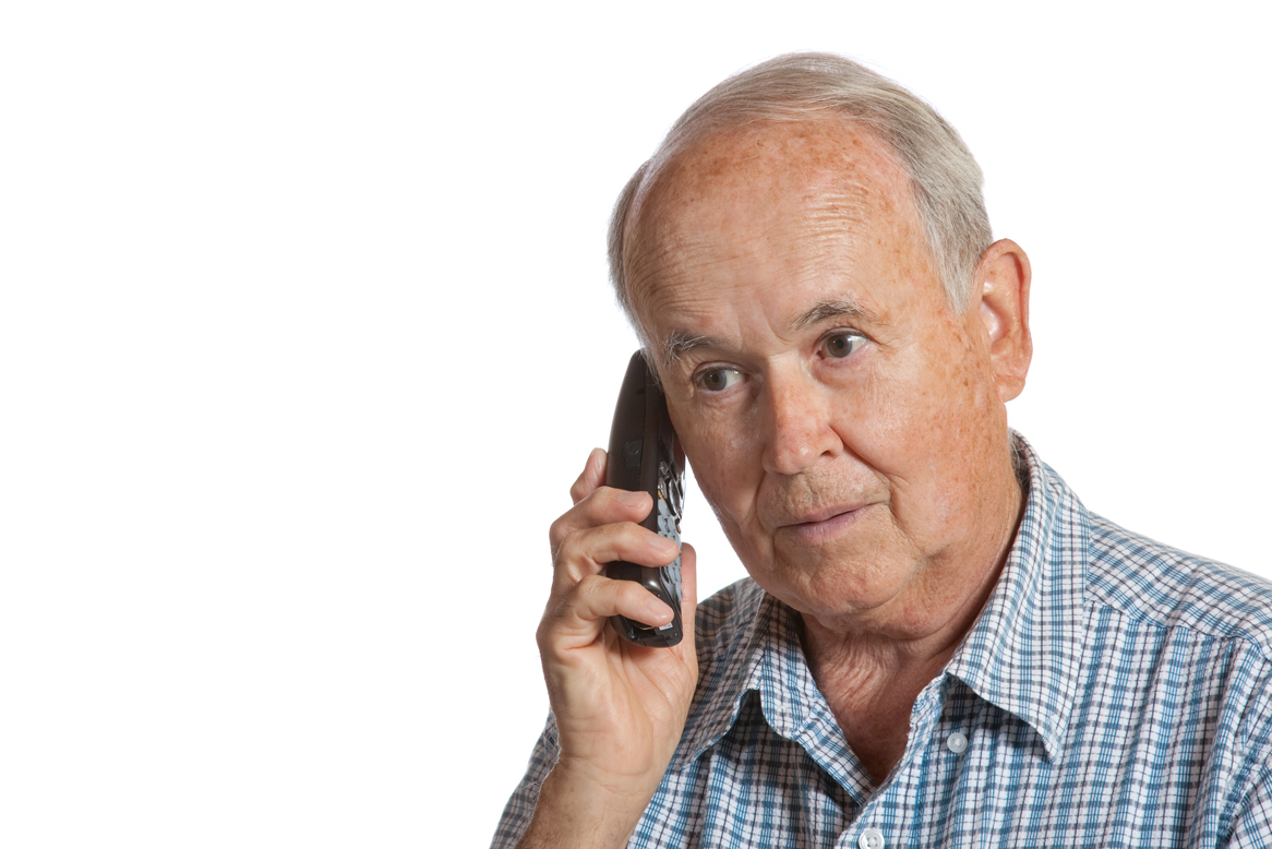 Elderly male talking on the telephone