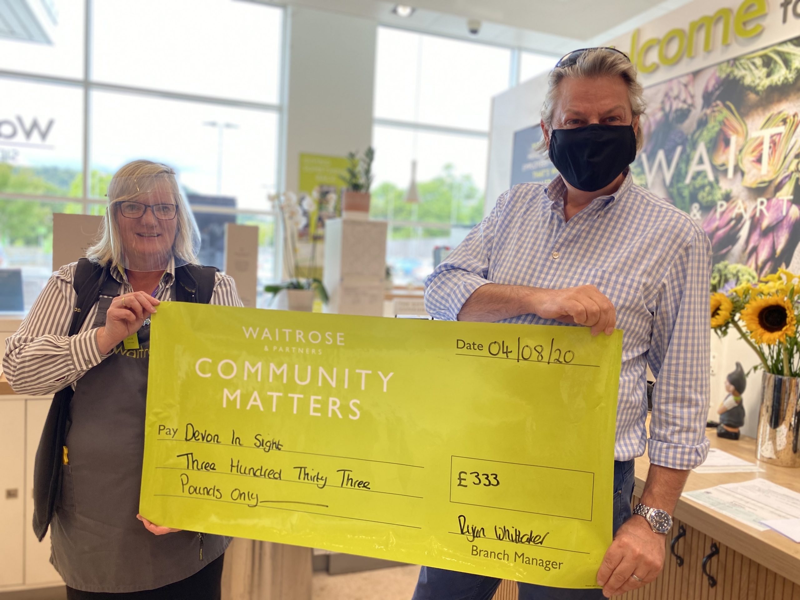 Julie Marish Community Lead Waitrose and Partners Sidmouth presenting Grahame CEO Devon in Sight with cheque as part of their Community Matters Campaign in May